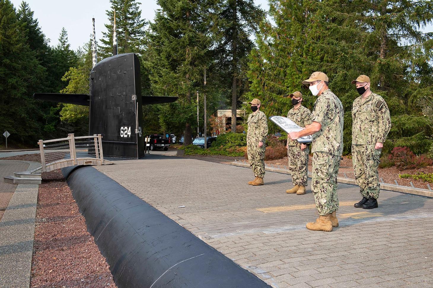 SILVERDALE, Wash. (Sept. 30, 2020) Rear Adm. Blake Converse, commander, Submarine Force, U.S. Pacific Fleet, presents The Arleigh Burke Fleet Trophy to the gold crew of USS Nebraska (SSBN 739), Sept. 30.