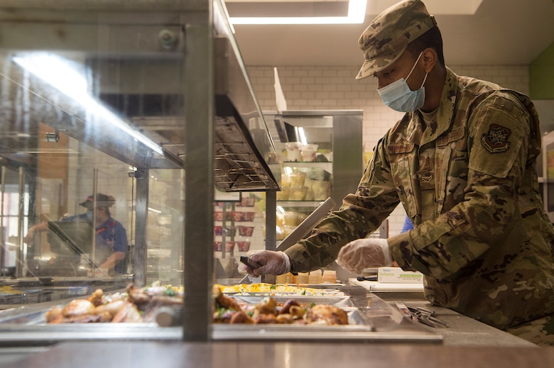 Airman Mr Gary Mcelrath, 628th Force Support Squadron food services apprentice, prepares meals on a food line at the Robert D. Gaylor Dining Facility at Joint Base Charleston, S.C., Nov. 2, 2020. Airmen and civilians who work at the dining facility work as part of a seven to 12 member team and serve meals to approximately 300 personnel during lunch hours. 628th FSS members ensure service members and civilians are fed at Joint Base Charleston, but feeding the force is just one mission that the FSS team is responsible for. The four core areas of services are food service, lodging, readiness, and fitness and sports.