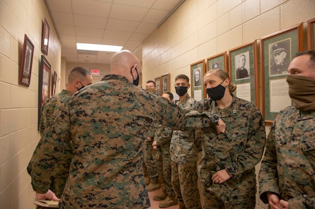The 19th Sergeant Major of the Marine Corps, Sgt. Maj. Troy E. Black, speaks with Marines attending The Basic School at Marine Corps Base Quantico, V.A., Nov. 2, 2020. During the visit Black discussed the relationship between officers and Staff Non-Commissioned officers that creates strong command teams capable of leading Marines with high morale and motivation. The Basic School educates newly commissioned or appointed officers in the high standards of professional knowledge, esprit-de-corps, and leadership to prepare them for duty in the operating forces. (U.S. Marine Corps photo by Sgt. Victoria Ross)