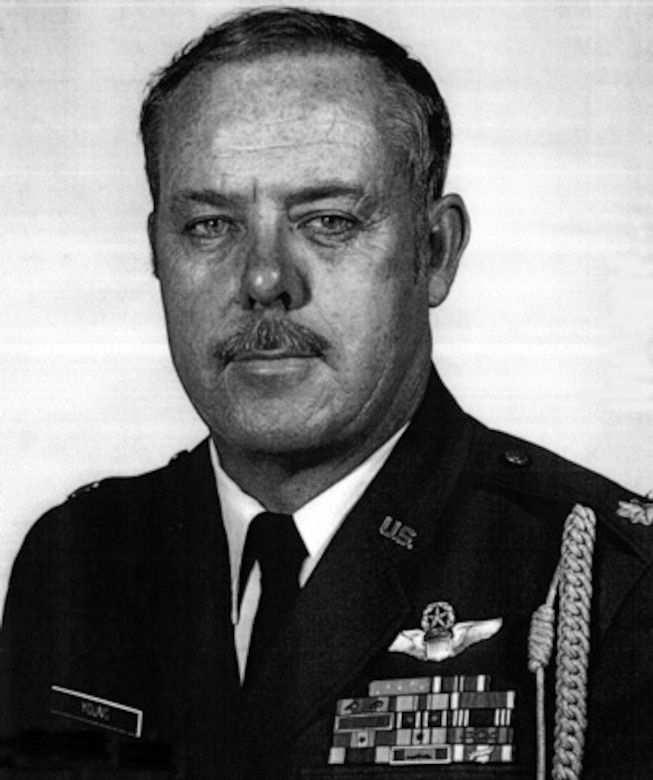 A man in military uniform  poses for a photo.