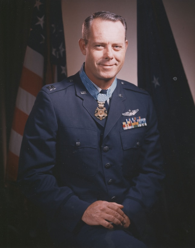 A man in uniform wearing a medal around his neck.