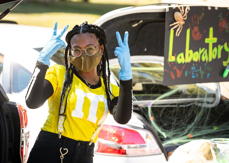 Airman Jonnica Blaylock, a Barksdale volunteer, poses for a photo during the Trunk or Treat event at Barksdale Air Force Base, La., Oct. 31, 2020.