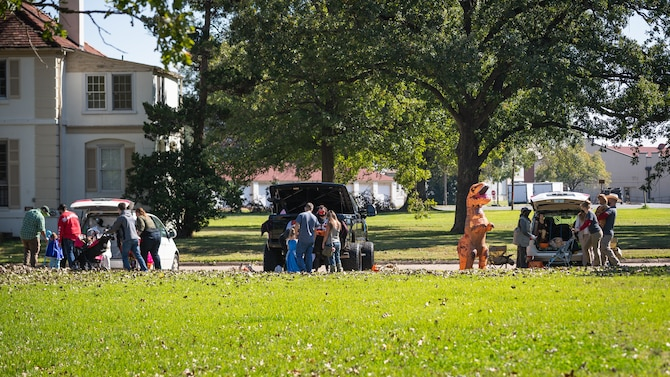 Members of the Barksdale community walk from car to car during the Trunk or Treat event at Barksdale Air Force Base, La., Oct. 31, 2020.