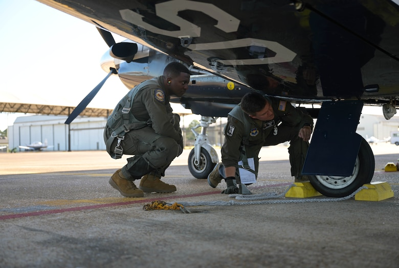 U.S. Air Force Maj. Samuel Berryhill (right), 41st Flying Training Squadron instructor pilot, shows 2nd Lt . Clifford Mua, 41st Flying Training Squadron student pilot, the pre-flight check procedures on the T-6 Texan II Nov. 4, 2020, on Columbus Air Force Base Miss. Instructor pilots learn how to train students at Pilot Instructor Training where they are taught to teach precise maneuvers in the T-6 Texan II, T-1 Jayhawk, or T-38 Talon. (U.S. Air Force photo by Senior Airman Jake Jacobsen)