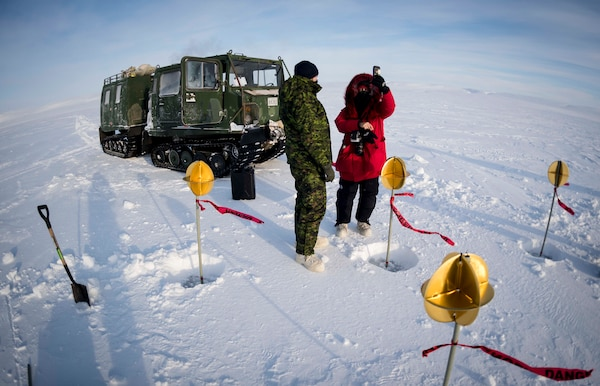 Canadian Armed Forces members set up satellite targets in ice, snow in Resolute Bay, Nunavut