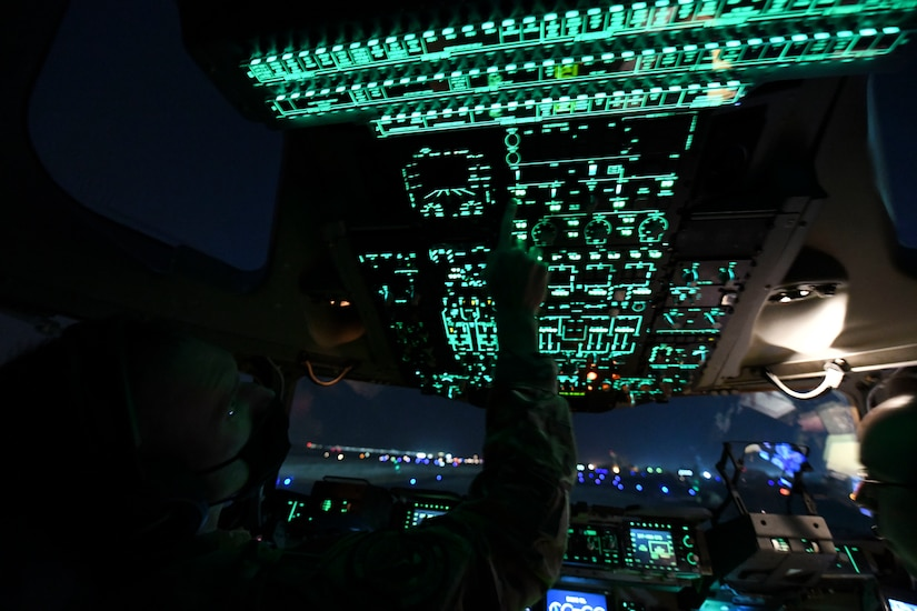 Lt. Col. Jonathan Baize, a C-17 Globemaster III pilot and 15th Airlift Squadron commander, prepares a C-17 for takeoff at Ali Al Salem Air Base, Kuwait, Oct. 30, 2020. Airmen assigned to the 15th AS replaced Airmen assigned to the 16th AS, who were returning home after a 90-day deployment. Both squadrons fly and operate C-17s assigned to the 437th Airlift Wing located at Joint Base Charleston, S.C.