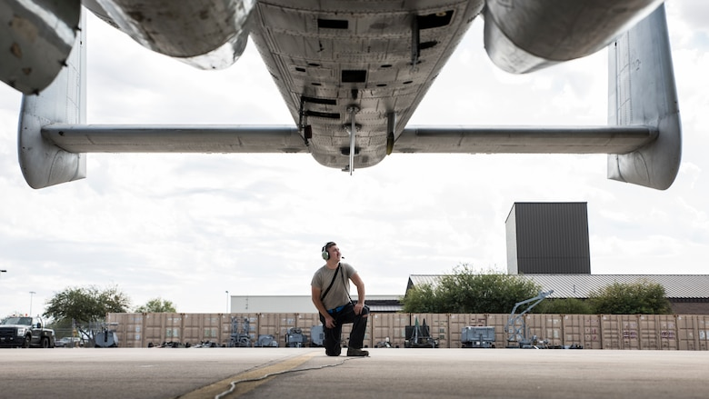 A photo of an Airman doing pre-flight inspections