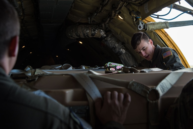 Staff Sgt. Alex Esquibel, 350th Air Refueling Squadron in-flight refueling specialist, loads cargo onto a KC-135 Stratotanker Oct. 15, 2020, at McConnell Air Force Base, Kansas. In addition to the KC-135's aerial refueling capabilities, it can also hold up to 83,000 pounds of cargo. (U.S. Air Force photo by Senior Airman Alexi Bosarge)