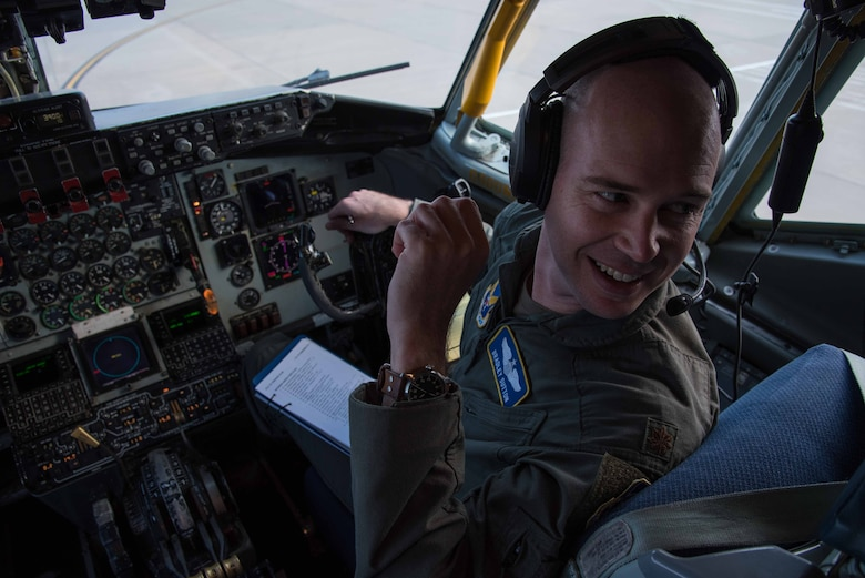"""Maj. Bradley Sutton, Air Force Flight Standards Agency Advanced Instrument School commandant, performs a preflight inspection on a KC-135 Stratotanker Oct. 15, 2020, at McConnell Air Force Base, Kansas. The crew made a round-trip flight to New Mexico where they refueled the United States Air Force Air Demonstration Squadron """"Thunderbirds"""" on their way to the Bell Fort Worth Alliance Air Show in Fort Worth, Texas. (U.S. Air Force photo by Senior Airman Alexi Bosarge)"""