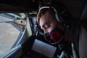 """Staff Sgt. Alex Esquibel, 350th Air Refueling Squadron in-flight refueling specialist, postitions the KC-135 Stratotanker's boom to refuel the United States Air Force Air Demonstration Squadron """"Thunderbirds"""" Oct. 15, 2020, at McConnell Air Force Base, Kansas. The KC-135 delivered 28,000 pounds of fuel to six Thunderbirds who were en route to the Bell Fort Worth Alliance Air Show in Fort Worth, Texas. (U.S. Air Force photo by Senior Airman Alexi Bosarge)"""