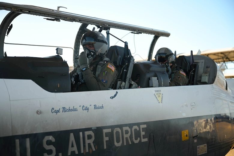U.S. Air Force 2nd Lt. Clifford Mua (left), 41st Flying Training Squadron student pilot, and Maj. Samuel Berryhill, 41st Flying Training Squadron instructor pilot, begin flight preparations in the T-6 Texan II Nov. 4, 2020, on Columbus Air Force Base Miss. The T-6 aircraft is part of the second phase of Specialize Undergraduate Pilot Training where students learn aircraft flight characteristics, emergency procedures, takeoff and landing procedures, aerobatics and formation flying. (U.S. Air Force photo by Senior Airman Jake Jacobsen)