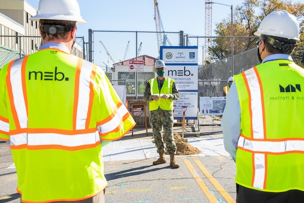 Norfolk Naval Shipyard (NNSY), RDML Howard Markle, addressed contractors and the NNSY workforce during a groundbreaking ceremony for its Dry Dock Floodwall Protection Improvements Project Nov. 4. The $43.6 million project will protect the small docks and their associated facilities, infrastructure, and equipment from flooding from the Elizabeth River.  This project is a part of the Shipyard Infrastructure Optimization Program (SIOP), a 20-year, $21 billion program dedicated to completely refurbishing the nation's four public shipyards by modernizing equipment, improving workflow and upgrading dry docks and facilities.