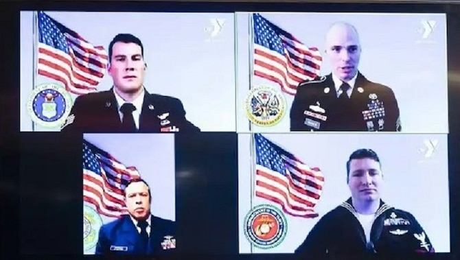 Image of four service members.