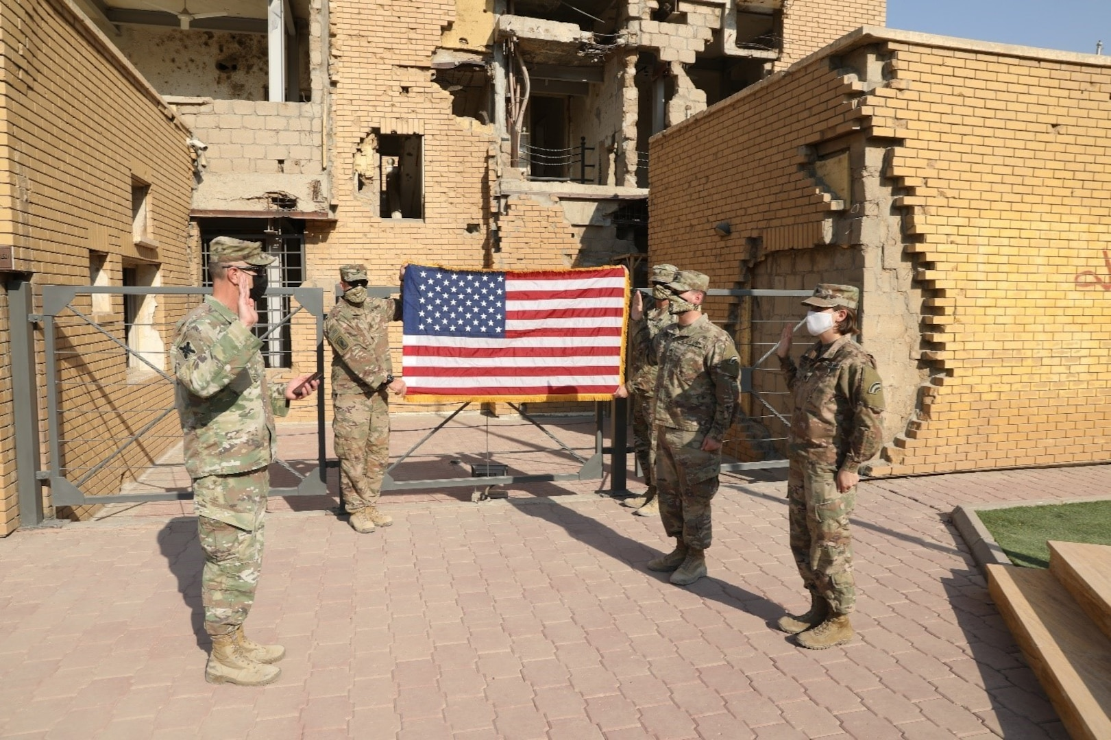 U.S. Army Staff Sgt. A. Jared Forst and Sgt. Becca Meerwarth take their oath of reenlistment Oct. 30, 2020, in Kuwait.