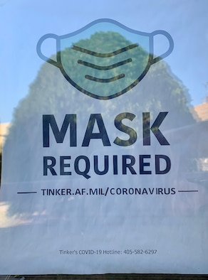 "Photo of ""mask required"" sign"
