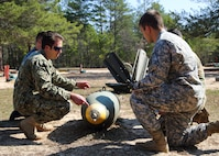 """170213-N-ML022-008 EGLIN AIR FORCE BASE, Fla. (Feb. 13, 2017) A Naval School Explosive Ordnance Disposal (NAVSCOLEOD) instructor conducts training with Explosive Ordnance Disposal (EOD) students during a """"day in the life of EOD"""" visit. NAVSCOLEOD  provides specialized, high-risk, basic and advanced EOD training to officer and enlisted personnel of all services, both U.S. and international, as well as select U.S. government personnel. (U.S. Navy photo by Mass Communication Specialist 3rd Class Brittany N. Tobin)"""