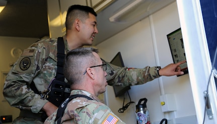 Alaska Air National Guard Capt. Roger Tran, the Nuclear Medical Science Officer for the 103rd Civil Support team, leads the unit in assessing biological hazards at a validation exercise in Anchorage, Aug. 4, 2020. Tran assisted the Alaska State Public Health laboratory during the COVID-19 pandemic. from early June to mid August (U.S. Army National Guard photo by Sgt. Seth LaCount/Released)