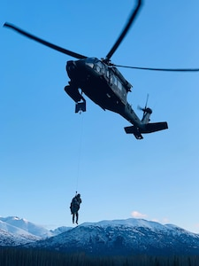 Members of the Alaska Army National Guard's 207th Aviation Regiment, led by Chief Warrant Officer Two Paul Gillquist, conduct hoist training on Joint Base Elmendorf-Richardson in the winter, Feb. 20, 2020. Gillquist recently performed his first real-world rescue mission near the village of Tyonek on Sept. 13, 2020.. (Courtesy photo)
