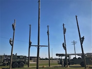 200415-N-N0443-0003 GULFPORT, Miss. (April 15, 2020) Construction Electrician C-1 Advanced Class 20020 staff and students maintain physical distancing during a pole climbing exercise at Naval Construction Training Center Gulfport, Mississippi, as they follow CDC guidelines to the extent applicable as part of the training center's proactive approach to combat COVID-19. Construction electricians build, maintain and operate power production facilities and electrical distribution systems for naval installations and support the Navy and Marine Corps operational and expeditionary forces worldwide. (U.S. Navy photo)