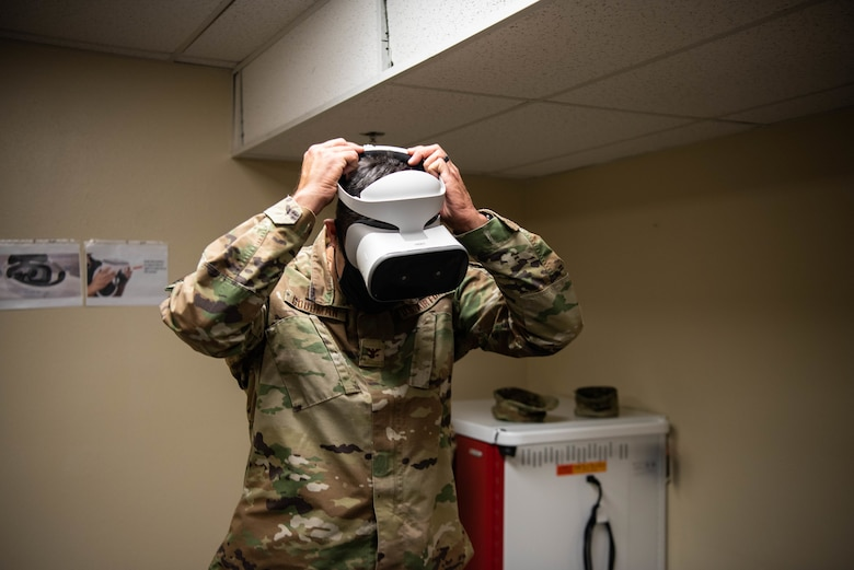 U.S. Air force Col. Richard A. Goodman, 366th Fighter Wing Commander, tries on the VR headset on Mountain Home Air Force Base, ID, Nov. 5, 2020. This program is focused on developing training videos for new Airmen who need to learn the basics of launching, recovering and refueling an aircraft. (U.S. Air Force photo by Airman 1st Class Cheyenne Bassham)