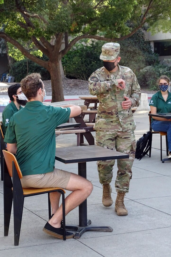 Photo of Maj. Gen. John Shaw meeting Cal Poly CubeSat Lab program students.