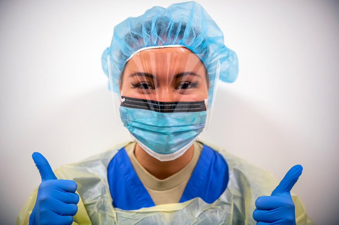U.S. Air Force Senior Airman Amber Potter, 423d Medical Squadron dental assistant, poses for a portrait, April 14, 2020, at RAF Alconbury, England. Despite having to operate at 50% manning since March, many MDS Airmen have excelled in implementing the necessary measures and processes to ensure the safety of the Pathfinder family. (U.S. Air Force photo by Senior Airman Eugene Oliver)