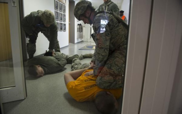U.S. Air Force Tech. Sgt. Jason Plasner, 52nd Fighter Wing executive assistant to the command chief, acts as an active shooter during an exercise at Spangdahlem Air Base, Germany, Feb. 22, 2017. The realistic scenario involved a disgruntled Airman simulating an active shooter attack on the base. (U.S. Air Force photo by Staff Sgt. Dawn M. Weber)
