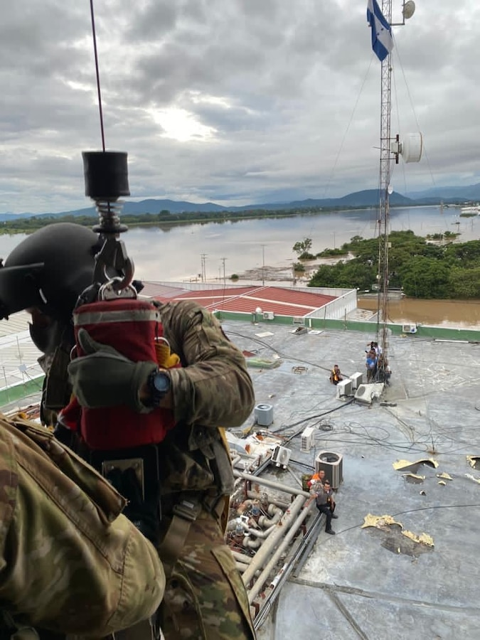 A U.S. HH-60 Black Hawk helicopter assigned to the 1-228th Aviation Regiment, Joint Task Force-Bravo rescued victims of Hurricane Eta stranded in floodwaters.