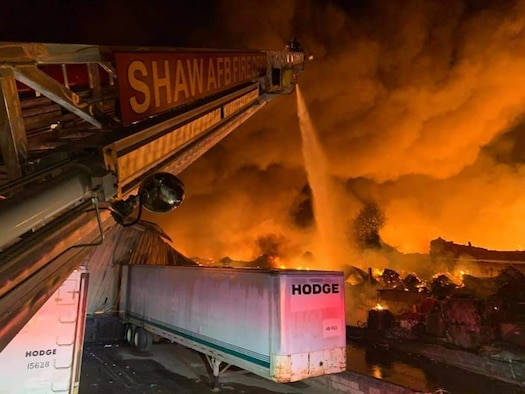 Photo of 20th Civil Engineer Squadron Fire Department putting out a fire in downtown Sumter South Carolina, oct. 27, 2020.