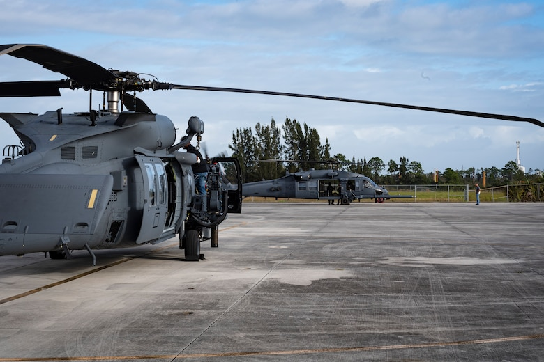 A photo of two helicopters