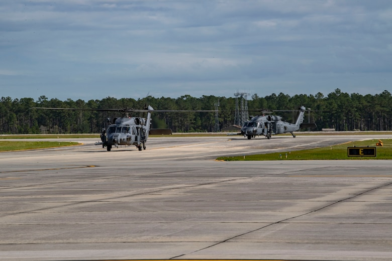 A photo of helicopters taxiing
