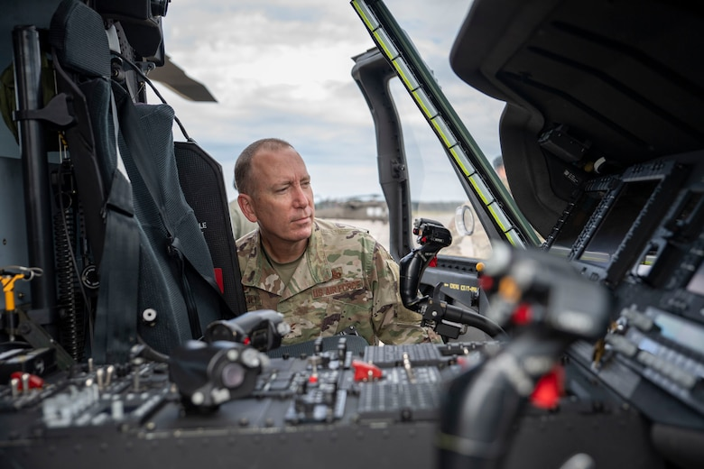 A photo of an Airman looking inside a helicopter