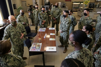 Master Chief Petty Officer of the Navy (MCPON) Russell Smith speaks with Sailors during lunch.