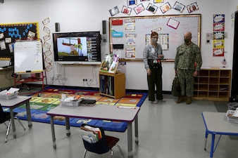 Master Chief Petty Officer of the Navy (MCPON) Russell Smith speaks with Penelope Miller-Smith, Department of Defense Education Activity Bahrain's elementary principal, during a visit to the school.