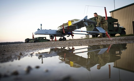 U.S. Army Spc. Christopher Cardwell, Delta Company, 776th Brigade Engineer Battalion, Detachment 1, Unmanned Aircraft Systems maintainer, prepares a RQ-7B Shadow for flight during Bold Quest 20.2 at Camp Atterbury, Indiana, Oct. 30, 2020. Bold Quest is a collaborative joint and multinational enterprise in which Nations, Services and Programs pool their resources in a recurring cycle of capability development, demonstration and analysis. Conceived in 2001, the BQ coalition has grown since 2003 from the U.S. services and four nations to now include 18 Partner Nations and NATO Headquarters.