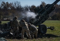 Soldiers with the Indiana Army National Guard conduct a field artillery fire mission during Exercise Bold Quest 20.2 at Camp Atterbury, Indiana, Oct. 31, 2020. Led by the Joint Staff, Bold Quest is a multinational training demonstration to test a joint capability to link sensors to shooters across air, land, sea, space and cyberspace.