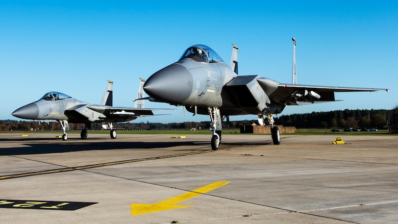 F-15C Eagles assigned to the 493rd Fighter Squadron await clearance for  take off in support of exercise Crimson Warrior at Royal Air Force Lakenheath, England, Nov. 4, 2020. Multi-domain integration exercises like Crimson Warrior strengthen NATO interoperability and test high-end capabilities in a contested, degraded, and operationally limited environment. (U.S. Air Force photo by Airman 1st Class Jessi Monte)