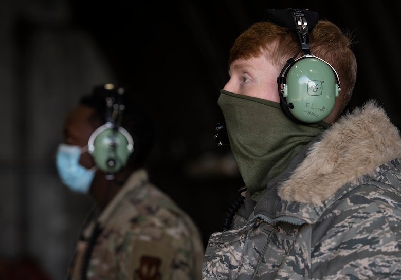 U.S. Air Force Airman 1st Class Forest Lovett, 748th Aircraft Maintenance Squadron Crew Chief, maintains visual communication with aircrew during pre-flight checks in support of exercise Crimson Warrior at Royal Air Force Lakenheath, England, Nov. 6, 2020. Multi-domain integration exercises like Crimson Warrior strengthen NATO interoperability and test high-end capabilities in a contested, degraded, and operationally limited environment. (U.S. Air Force photo by Airman 1st Class Jessi Monte)