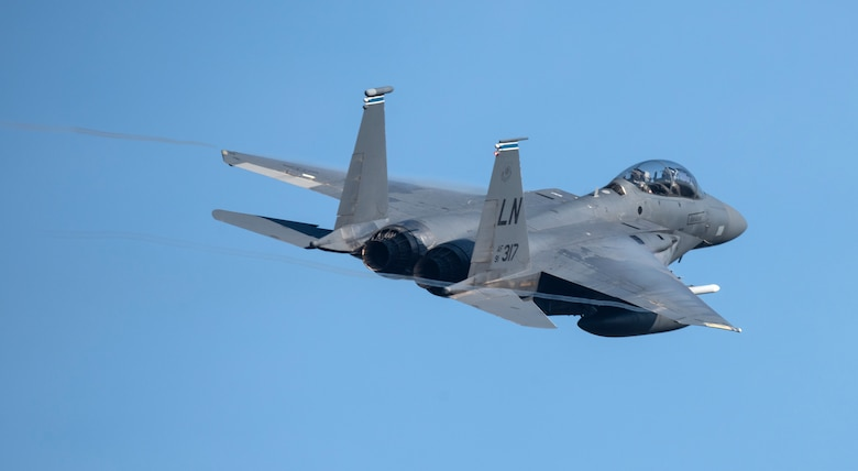 An F-15E Strike Eagle assigned to the 492nd Fighter Squadron takes off in support of exercise Crimson Warrior at Royal Air Force Lakenheath, England, Nov. 6, 2020. Multi-domain integration exercises like Crimson Warrior strengthen NATO interoperability and test high-end capabilities in a contested, degraded, and operationally limited environment. (U.S. Air Force photo by Airman 1st Class Jessi Monte)