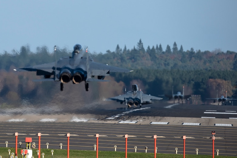 F-15E Strike Eagles and F-15C Eagles assigned to the 48th Fighter Wing land after completion of a training sortie in support of exercise Crimson Warrior at Royal Air Force Lakenheath, England, Nov. 6, 2020. Multi-domain integration exercises like Crimson Warrior strengthen NATO interoperability and test high-end capabilities in a contested, degraded, and operationally limited environment. (U.S. Air Force photo by Airman 1st Class Jessi Monte)