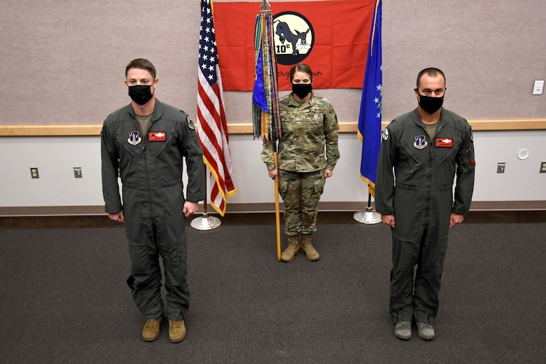 110th Bomb Squadron leadership stands at attention during an assumption of command ceremony, Oct. 24, 2020, at The Technical Sergeant Luke C.A. Ford Auditorium on Whiteman Air Force Base, Mo. Lt. Col. Matthew Howard (right) took command of the squadron after Lt. Col. Luke Jayne (left) was promoted to 131st Operations Group Commander earlier this year. (U.S. Air National Guard photo by Staff Sgt. Joshua Colligan)