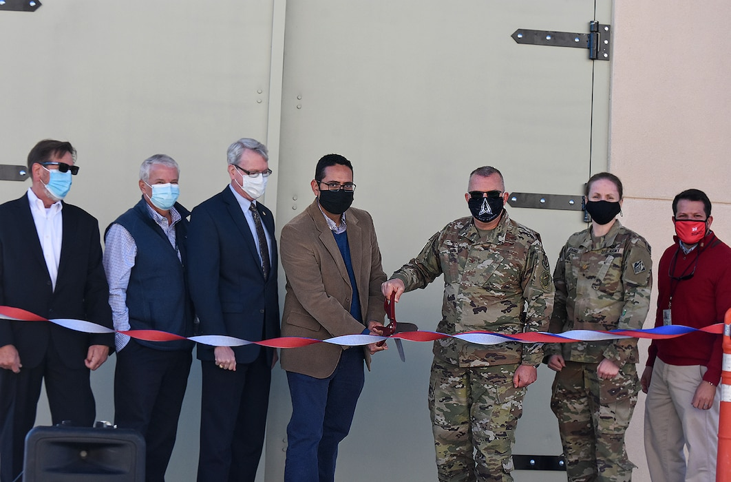 Kirtland Air Force Base, N.M. – Maj. Katrina Johns, deputy commander, USACE-Albuquerque District (2nd from right) and Gamaliel Fuentes, project manager, USACE (far right) join Air Force Research Laboratory officials at a ribbon-cutting ceremony for the Deployable Structures Laboratory, Oct. 29, 2020.