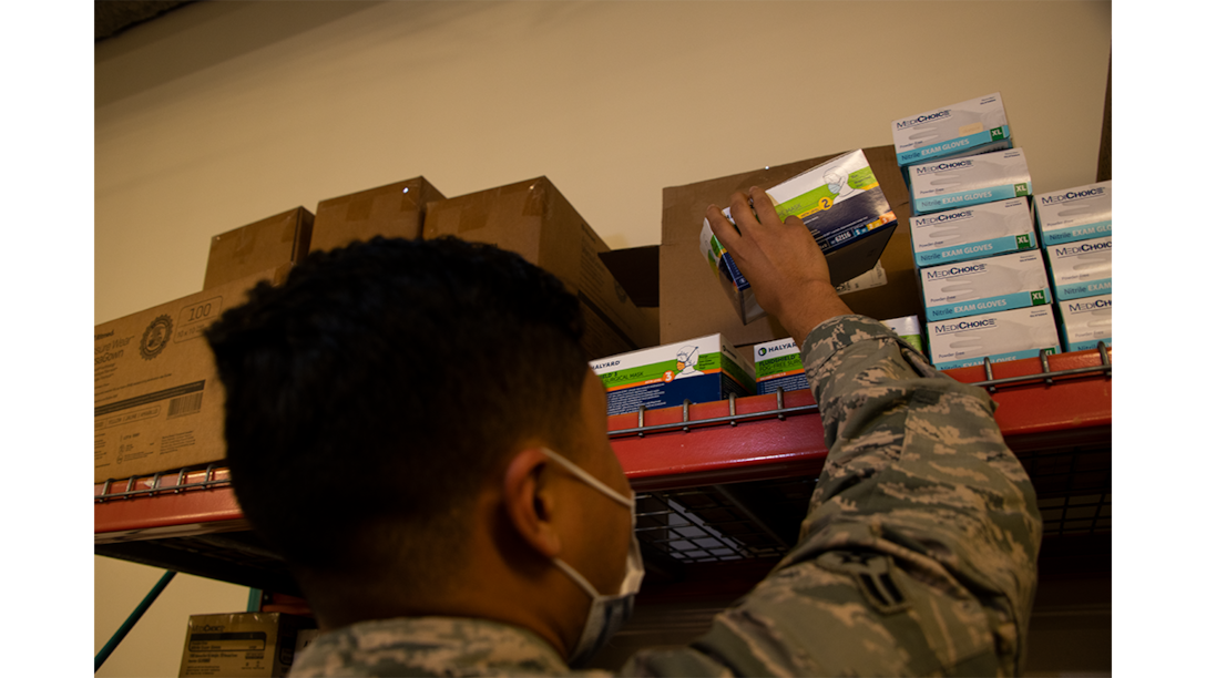 Airman 1st Class Yobanni Calderon, 42nd Medical Materiel professional, restocks personal protection equipment at the 42 MDG, November, 6, 2020. Calderon ensures availability of PPE for all MDG staff. The efforts of Calderon permit the MDG mission to continue during the current COVID-19 environment.(U.S. Air Force photo by Airman 1st Class Jackson Manske.)