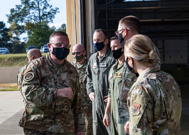 A photo of Airmen interacting with a command chief.
