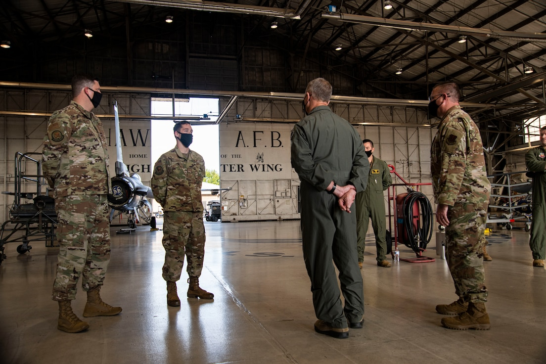 A photo of Airmen standing having a conversation.