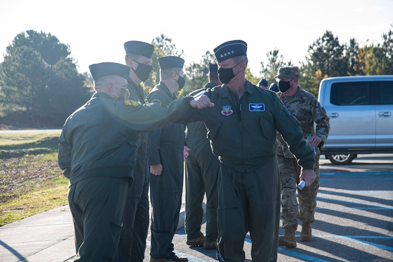 A photo of Airmen greeting a General.