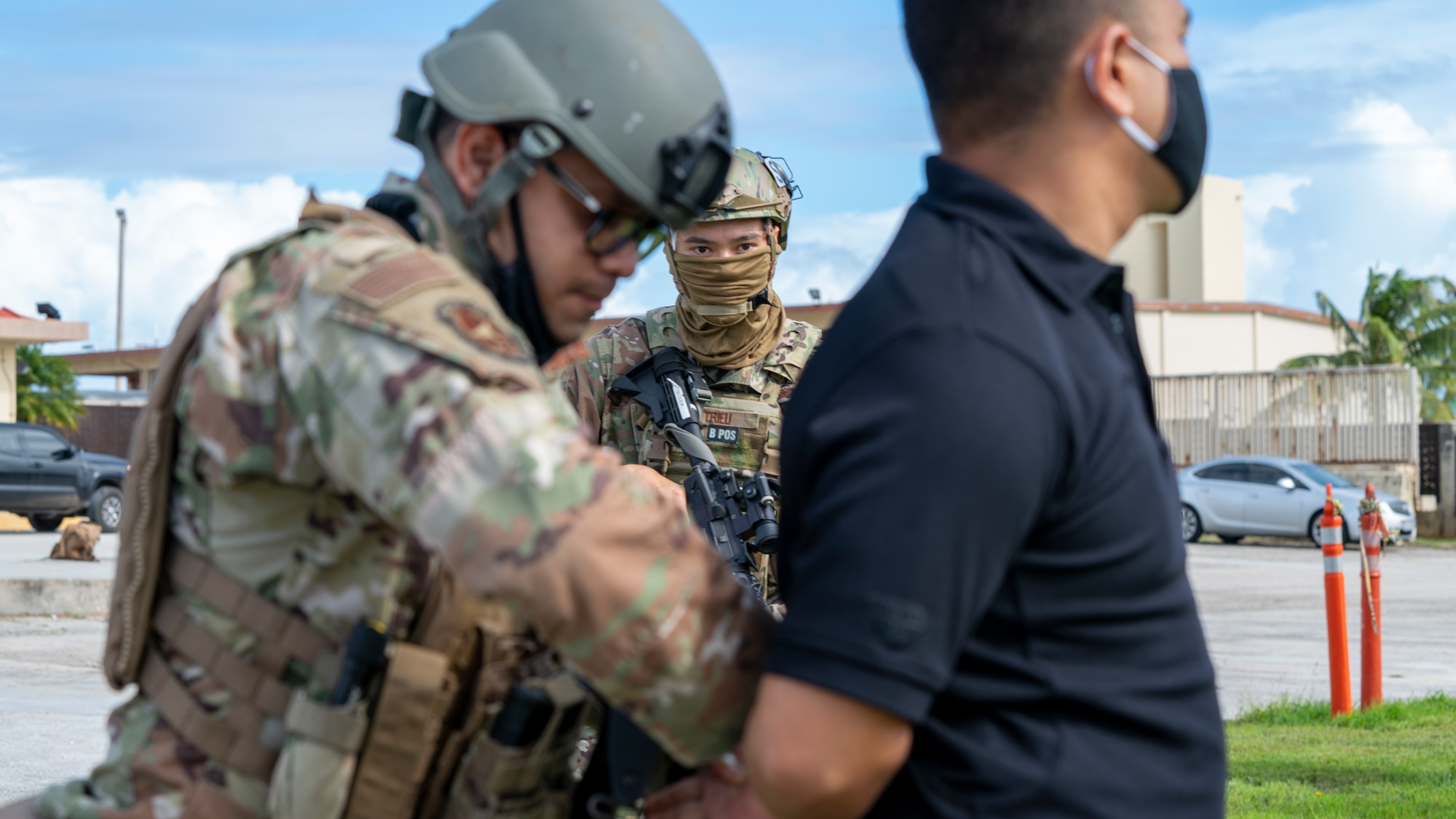 Members of the 736th Security Forces Squadron practice handcuffing a suspect during a flightline attack scenario as part of Exercise Sling Stone 21-1 on Nov. 5, 2020 at Andersen Air Force Base, Guam. Exercise Sling Stone is an annual anti-terrorism force protection exercise. The exercise involved multiple training scenarios intended to prepare service members to respond to emergency situations. (U.S. Air Force photo by Tech. Sgt. Esteban Esquivel)