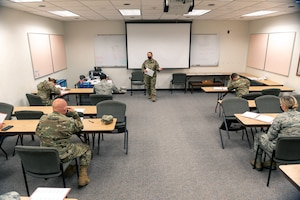 Airmen briefing room about mobility folders.