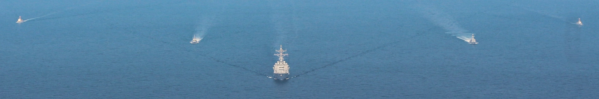 201105-N-N0146-1589 ARABIAN GULF (Nov. 05 2020) The guided-missile destroyer USS Ralph Johnson (DDG 114), Kuwait Naval Force missile boat Al- Saadi (P 3723), Kuwait Coast Guard fast patrol boat Marzoug (P 314) and U.S. Coast Guard patrol boats USCGC Aquidneck (WPB 1309) and USCGC Monomoy (WPB 1326) steam in formation during a joint maritime security patrol exercise in the Arabian Gulf, Nov. 5. Ralph Johnson is part of Nimitz Carrier Strike Group and is deployed to the U.S. 5th Fleet area of operations to ensure maritime stability and security in the Central Region, connecting the Mediterranean and Pacific through the Western Indian Ocean and three critical chokepoints to the free flow of global commerce.