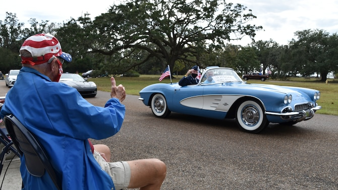 Col. Jeffrey A. Van Dootingh, 403rd Wing commander, waves at veterans and staff gathered for the Gulf Coast Veterans Day Roll-Thru and Wave event at the Armed Forces Retirement Home, Gulfport, Mississippi, Nov. 7, 2020. The celebration featured a parade of vintage automobiles, first responder vehicles and a C-130J Super Hercules flyover by the 815th Airlift Squadron. (U.S. Air Force photo by Tech. Sgt. Michael Farrar)